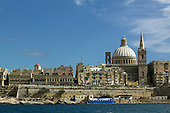 Carmelite church (dome) and St Paul's Anglican pro-cathedral (steeple) Valletta Malta as seen from Marsamxett Harbour