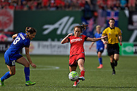 Portland, Oregon - Sunday May 29, 2016: Portland Thorns FC midfielder Meleana Shim (6) is marked by Seattle Reign FC defender Kendall Fletcher (13). The Portland Thorns play the Seattle Reign during a regular season NWSL match at Providence Park.