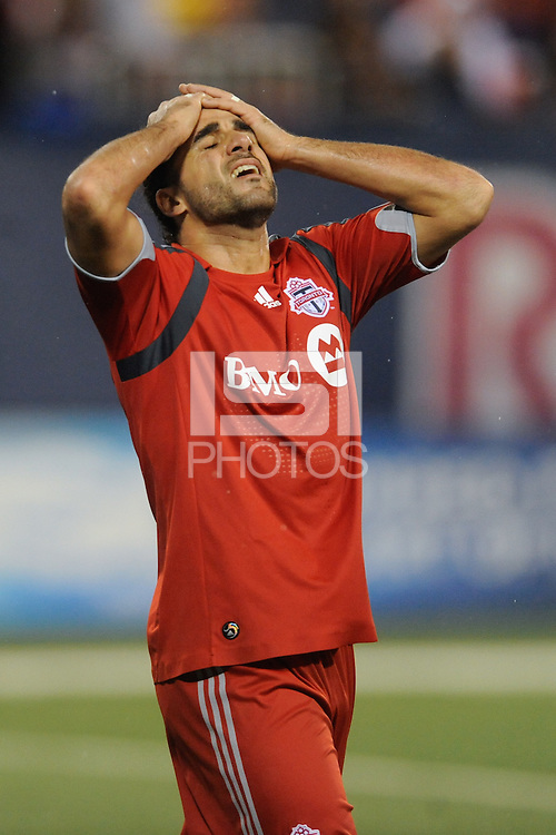 Dwayne De Rosario (14) of Toronto FC reacts to missing a scoring oportunity. The New York Red Bulls defeated Toronto FC 5-0 during a Major League Soccer match at Giants Stadium in East Rutherford, NJ, on October 24, 2009.