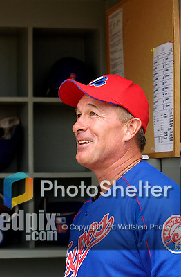 "28 February 2003: Hall of Fame catcher, and former Montreal Expo, Gary ""The Kid"" Carter chats with active Expos players in the dugout prior to a Spring Training game at Space Coast Stadium in Viera, Florida. Carter became the first Montreal Expo to be inducted into the Baseball Hall of Fame later that year. Mandatory Credit: Ed Wolfstein Photo"