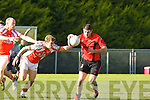 Eamon Kiely Brosna tackles Chris Myers Fossa during their Div 5 clash in Brosna on Sunday