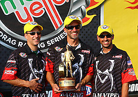Oct 6, 2013; Mohnton, PA, USA; NHRA pro stock motorcycle rider Matt Smith (center) celebrates with teammates John Hall (left) and Scotty Pollacheck after winning the Auto Plus Nationals at Maple Grove Raceway. Mandatory Credit: Mark J. Rebilas-