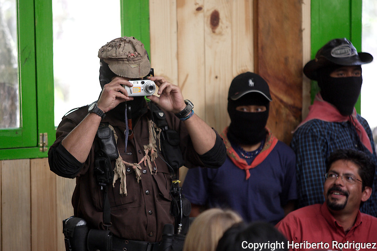 Zapatista subcomandante Marcos takes a snap prior to the beginning of a meeting with citizens and people organizations in San Cristobal de las Casas and starting a six-month tour all over Mexico, January 2nd. 2006. Marcos started The Other Campaign to meet people and organizations to promote an anti-capitalism and anti-neoliberal program. The Zapatistas started an uprising twelve years ago demanding better living conditions for the Indian people in Mexico. Photo by Heriberto Rodriguez..