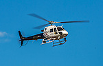 6 April 2015: A Washington DC Municipal Police helicopter, a Bell Jet Ranger, flies over the Washington Nationals Home Opening Game against the New York Mets at Nationals Park in Washington, DC. The Mets rallied to defeat the Nationals 3-1 in their first meeting of the 2015 MLB season. Mandatory Credit: Ed Wolfstein Photo *** RAW (NEF) Image File Available ***