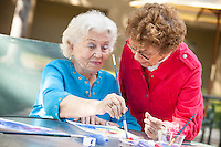 Senior Woman Painting Pictures with a Friend