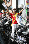 July 6, 2010 - Tokyo, Japan -  Candidate for the upcoming upper house election Hidemitsu Sano rides his Honda Goldwing GL1800 trike are pictured in Tokyo on July 6, 2010. Founder of the The Shinto Honshitsu (Essential Party) in 2009, Sano is a one-man band self-styled political party who has a passion for tuned cars and motorcycles, which are a feature of his political campaigning.
