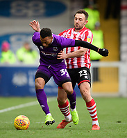 Grimsby Town's Wes Thomas shields the ball from Lincoln City's Neal Eardley<br /> <br /> Photographer Chris Vaughan/CameraSport<br /> <br /> The EFL Sky Bet League Two - Lincoln City v Grimsby Town - Saturday 19 January 2019 - Sincil Bank - Lincoln<br /> <br /> World Copyright © 2019 CameraSport. All rights reserved. 43 Linden Ave. Countesthorpe. Leicester. England. LE8 5PG - Tel: +44 (0) 116 277 4147 - admin@camerasport.com - www.camerasport.com