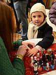 Katie Fitzgerald gets her nails painted at the Stamullen Christmas market. Photo:Colin Bell/pressphotos.ie