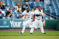 Syracuse Chiefs center fielder Brian Goodwin (15) running the bases as coach Brian Daubach (47) directs during a game against the Louisville Bats on June 6, 2016 at NBT Bank Stadium in Syracuse, New York.  Syracuse defeated Louisville 3-1.  (Mike Janes/Four Seam Images)