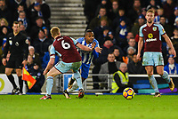 Jose Izquierdo of Brighton & Hove Albion (19) and Ben Mee of Burnley (6) challenge for the ball and Brighton appeal for a second penalty  during the EPL - Premier League match between Brighton and Hove Albion and Burnley at the American Express Community Stadium, Brighton and Hove, England on 16 December 2017. Photo by Edward Thomas / PRiME Media Images.