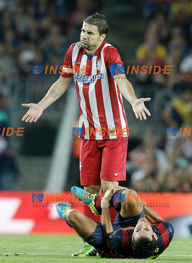 FC Barcelona's Sergio Busquets injured (d) and Atletico de Madrid's Gabi Fernandez during Supercup of Spain 2nd match.August 28,2013. (ALTERPHOTOS/Acero) <br /> Football Calcio 2013/2014<br /> La Liga Spagna Supercoppa di Spagna Barcellona - Atletico MAdrid <br /> Foto Alterphotos / Insidefoto <br /> ITALY ONLY