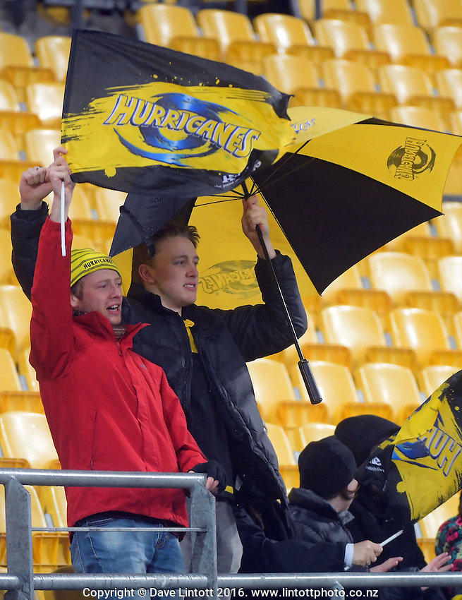 Fans brave the rain during the Super Rugby quarterfinal match between the Hurricanes and Sharks at Westpac Stadium, Wellington, New Zealand on Saturday, 23 July 2016. Photo: Dave Lintott / lintottphoto.co.nz