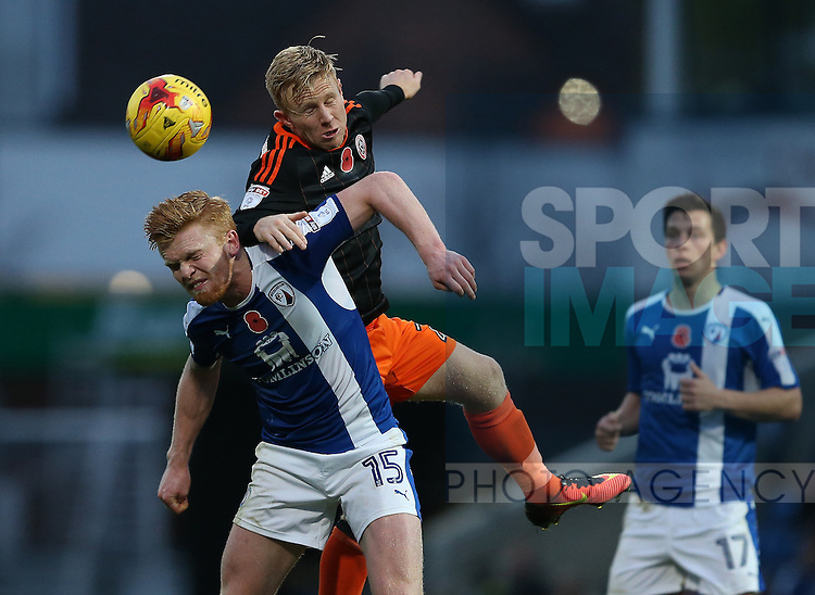 Mark Duffy of Sheffield Utd gets above Liam O'Neill of Chesterfield during the English League One match at the Proact Stadium, Chesterfield. Picture date: November 13th, 2016. Pic Simon Bellis/Sportimage