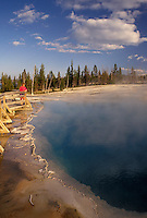 Yellowstone National Park, WY, Wyoming, Woman looking at Black Pool at West Thumb Geyser Basin in Yellowstone Nat'l Park in Wyoming.