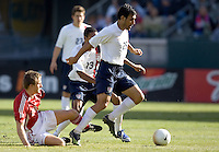 Pablo Mastroeni dribble the ball past a Denmark tackle. The USA defeated Denmark 3-1 in an International friendly at the Home Depot Center in Carson, CA on January 20, 2007.