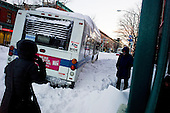 Brooklyn, New York<br /> December 27, 2010<br /> <br /> Snow blizzard on the East Coast. One of several stranded buses along 7th Avenue (the cross street is 9th Avenue).