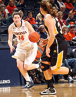 Dec. 18, 2010; Charlottesville, VA, USA; Virginia Cavaliers guard Lexie Gerson (14) moves the ball down court in front of UMBC Retrievers guard Erin Brown (30) during the game at the John Paul Jones Arena. Virginia won 61-46. Mandatory Credit: Andrew Shurtleff