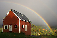 rainbow, Waterbury, VT, Vermont, A colorful rainbow appears over a small red house after a storm.
