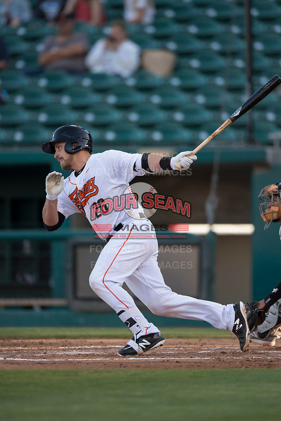 Fresno Grizzlies catcher Tim Federowicz (26) follows through on his swing during a Pacific Coast League game against the Salt Lake Bees at Chukchansi Park on May 14, 2018 in Fresno, California. Fresno defeated Salt Lake 4-3. (Zachary Lucy/Four Seam Images)