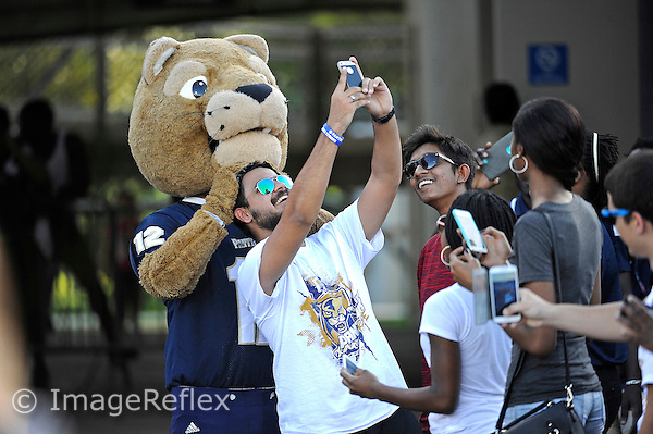 19 September 2015:  Roary poses for selfies with fans prior to the game as the FIU Golden Panthers defeated the North Carolina Central University Eagles, 39-14, at FIU Stadium in Miami, Florida.