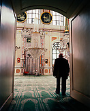 TURKEY, Istanbul, rear view of senior man in Ortekoy Mosque