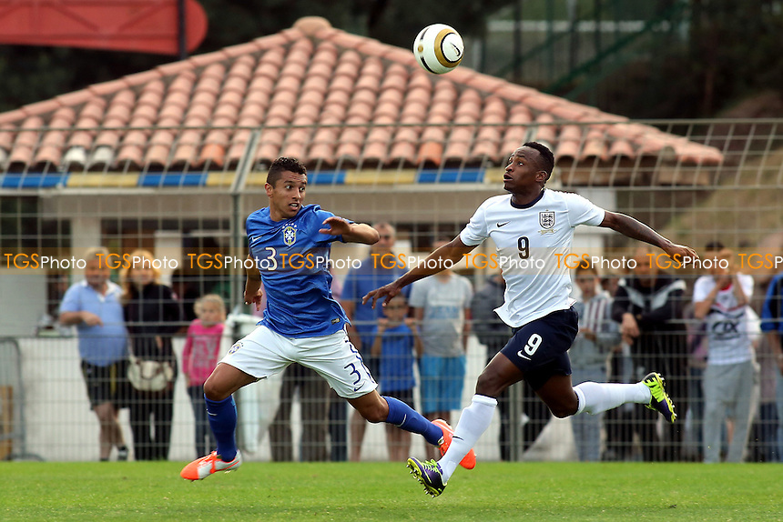 Marquinhos of Brazil and England's Saido Berahino - England Under-20 vs Brazil Under-20 - Toulon Tournament Group B Football at Stad L Hon, Saint Raphael, France - 26/05/14 - MANDATORY CREDIT: Paul Dennis/TGSPHOTO - Self billing applies where appropriate - contact@tgsphoto.co.uk - NO UNPAID USE
