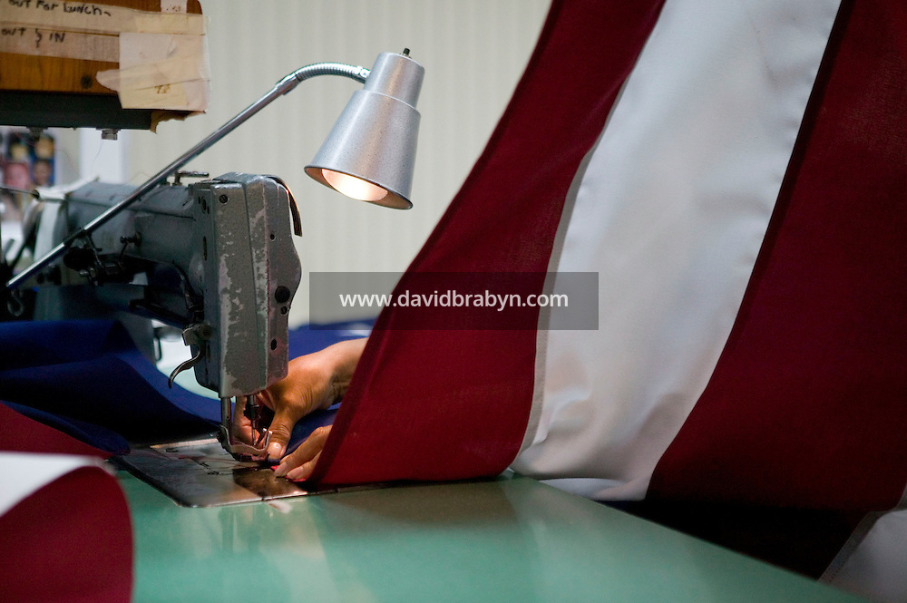 21 June 2005 - Oaks, PA - Connie Roby (hidden) assembles parts of an American flag at the Annin & Co. flag manufacturing plant in Oaks, PA. Photo Credit: David Brabyn.