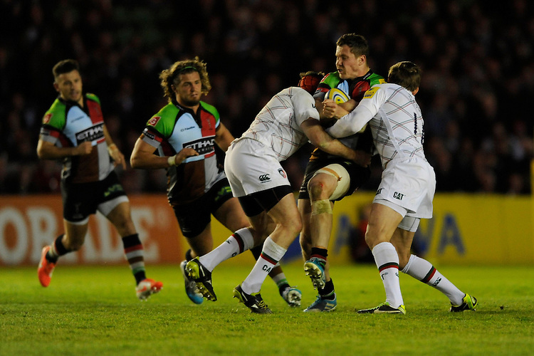 Tim Molenaar of Harlequins is tackled by Julian Salvi and Toby Flood of Leicester Tigers during the Aviva Premiership match between Harlequins and Leicester Tigers at the Twickenham Stoop on Friday 18th April 2014 (Photo by Rob Munro)