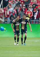 Philadelphia Union midfielder Sebastien Le Toux #9 and Philadelphia Union midfielder/forward Kyle Nakazawa #13 embrace after a goal during an MLS game between the Philadelphia Union and the Toronto FC at BMO Field in Toronto on May 28, 2011..The Philadelphia Union won 6-2..