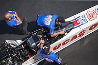 Sep 17, 2016; Concord, NC, USA; Cew members with NHRA top fuel driver Richie Crampton during qualifying for the Carolina Nationals at zMax Dragway. Mandatory Credit: Mark J. Rebilas-USA TODAY Sports