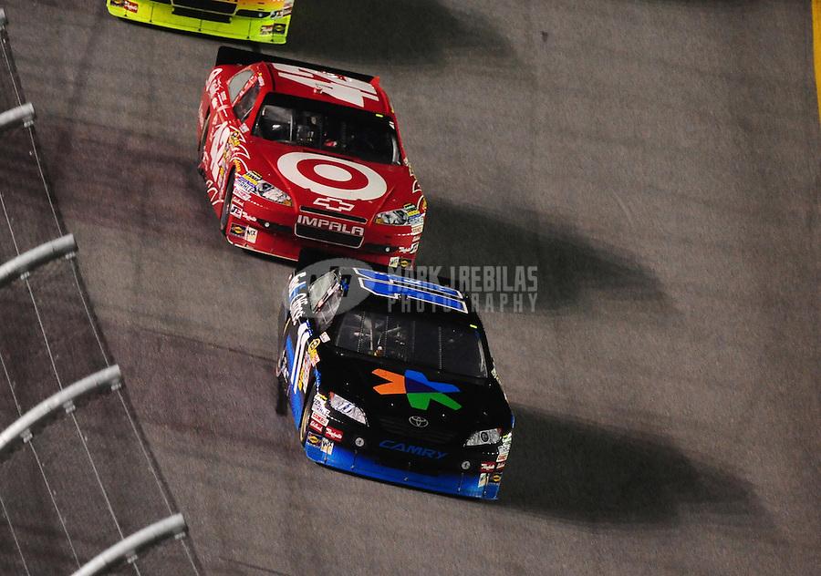Jul. 3, 2010; Daytona Beach, FL, USA; NASCAR Sprint Cup Series driver Denny Hamin (11) leads Juan Pablo Montoya (42) during the Coke Zero 400 at Daytona International Speedway. Mandatory Credit: Mark J. Rebilas-