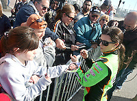 Race car driver Danica Patrick signs autographs during a break in her first stock car test at Daytona International Speedway on Saturday, December 19, 2009.  The test session is the first step in her recently announced plans to compete in NASCAR next season.  (Photo by Brian Cleary/www.bcpix.com)