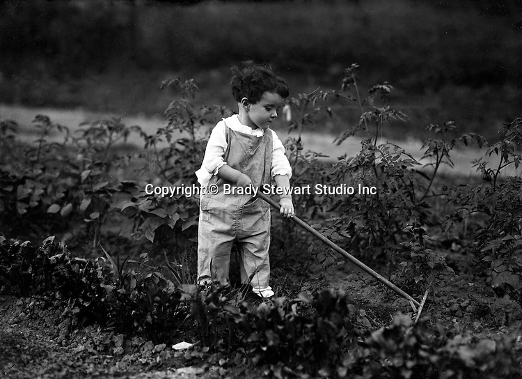 Point Breeze:  Helen Stewart working in Grandpa's Victory Garden - 1919. During this time the Stewart's lived at 6705 Thomas Street in Point Breeze
