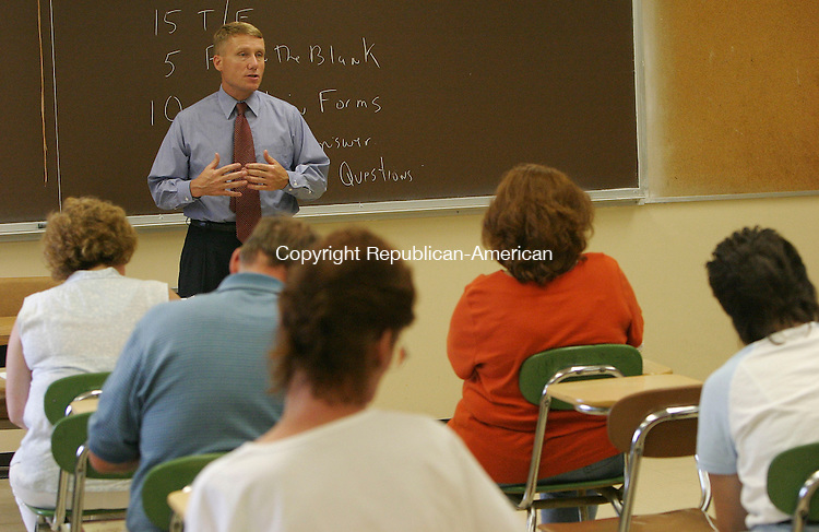 WATERBURY, CT 19 July 2005 -071905BZ09- Walter Lippincott teaches a legal assistant/paralegal class at Naugatuck Valley Community College in Waterbury Monday. <br /> Jamison C. Bazinet Photo