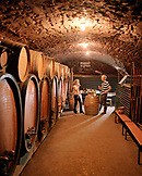 FRANCE, Montigny-les-Arsures, Arbois, guests sip Vin Jaune in the tasting room, Jacques Puffeney Winery, Jura Wine Region