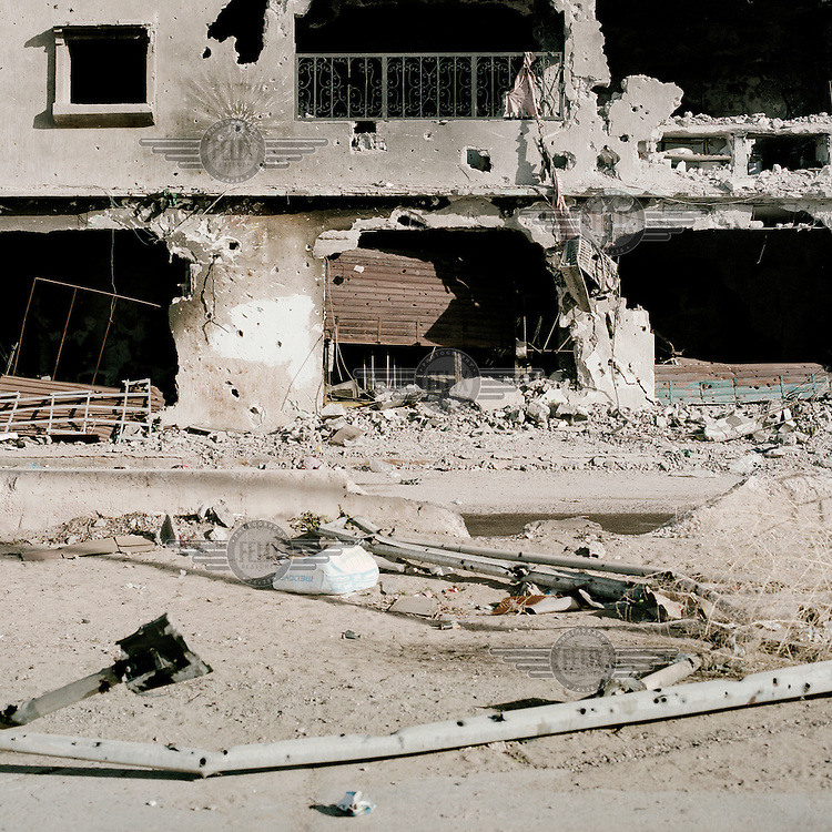 A shelled and destroyed residential building in Sirte.