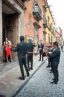 Mariachis singing for/with a couple outside a hotel in San Miguel de Allende, Guanajuato, Mexico