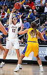 SIOUX FALLS, SD: MARCH 6: Caitlyn Tolen #12 from IUPUI passes over the defense of Kerri Young #10 from South Dakota State during the Summit League Basketball Championship on March 6, 2017 at the Denny Sanford Premier Center in Sioux Falls, SD. (Photo by Dave Eggen/Inertia)