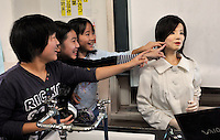 Pupils touch the world's first robot teacher, SAYA, after a lesson in a Tokyo pimary school. SAYA has been in development for the past 15 years by Professor Hiroshi Kobayashi at the Department of Mechanical Engineering at Tokyo University of Science. SAYA can talk and has a full range of facial expressions..