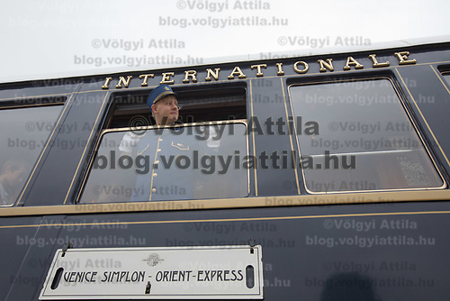 Steward looks out of a window while people visit cars of the Venice Simplon Orient Express open for the audience at the Hungarian Railway Museum in Budapest, Hungary on Aug. 26, 2018. ATTILA VOLGYI