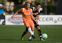 Megan Schnur (left) passes the ball against Christine Sinclair (right). FC Gold Pride defeated Sky Blue FC 1-0 at Buck Shaw Stadium in Santa Clara, California on May 3, 2009.