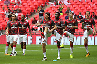 Arsenal players warm up pre-match during Arsenal vs Chelsea, FA Community Shield Football at Wembley Stadium on 6th August 2017