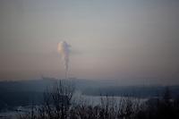A smokestack stands above Ufa, Bashkortostan, Russia.