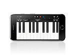 Apple iPhone 7 Plus with piano keyboard Garage Band Apple music app on its display isolated on white background with clipping path