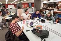 From left to right: Adnan Shihabi '20, Pierce Dimauro '20, Josh Yee '20 and Ana Bucy '20 all study for their human anatomy final in the computers & study area<br /> Occidental College students study for finals and write papers during finals week in the Academic Commons/Mary Norton Clapp Library, Monday afternoon, Dec. 10, 2018.<br /> (Photo by Marc Campos, Occidental College Photographer)