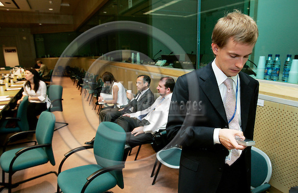 BRUSSELS - BELGIUM - 28 JULY 2006 -- Lauri VOIONMAA, Attache Foreign Relation Counsellors, the Permanent Representation of Finland to the EU recieving a e-mail before the beginning of the RELEX-meeting in the EU Council. -- PHOTO: ERIK LUNTANG / EUP-IMAGES..