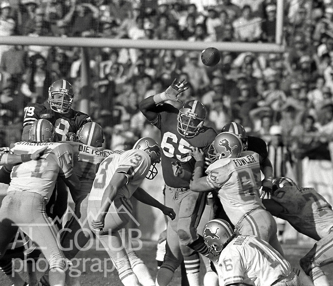 San Francisco 49ers vs. Detroit Lions at Candlestick Park Saturday, December 31, 1983..49ers beat the Lions 24-23.Detroit Lions Quarterback Gary Danielson (16) holds as Detroit Lions Kicker Eddie Murray (3) attempts field goal while San Francisco 49ers Defensive End Lawrence Pillers (65) goes for the block...