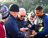 Callum Wilson of AFC Bournemouth signs an autograph during AFC Bournemouth vs Arsenal, Premier League Football at the Vitality Stadium on 25th November 2018