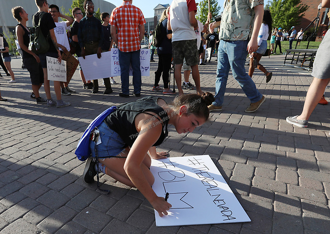 A young girl makes a sign during the Black Lives March Against Hate at the Joe Crowley Student Union on the University of Nevada campus in Reno, Nevada on Sunday, August 27, 2017.