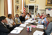 United States President Barack Obama meets with senior staff in Chief of Staff Denis McDonough's office in the West Wing of the White House, Sunday, Sept. 29, 2013.<br /> Mandatory Credit: Pete Souza - White House via CNP